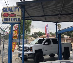 Prados-Quality-auto-repair-smog-outside-front-white-truck